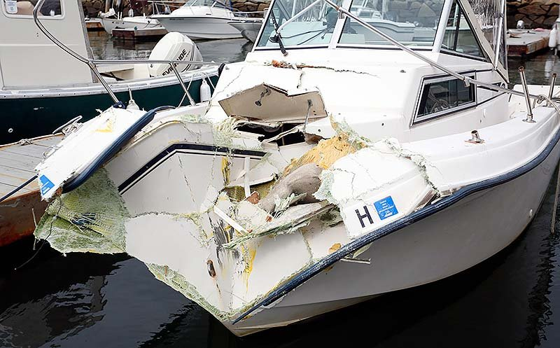 The damaged Miss M, a 20-foot Grady White Overnighter, is docked at Portland Yacht Services in Portland on Sunday. The Miss M and a water taxi collided Saturday night, injuring three people, including Portland financier S. Donald Sussman.