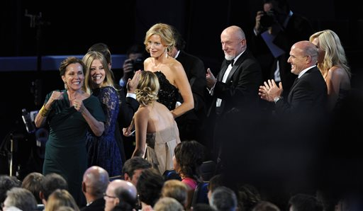 Anna Gunn, center, stands to accept the award for outstanding supporting actress in a drama series for her role on