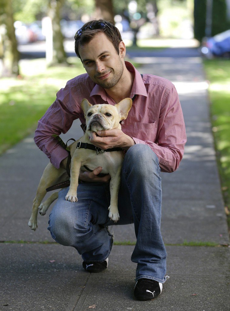 Aaron Brethorst poses for a photo while walking his dog, Moxie, in Seattle on Monday, Sept. 9, 2013. Brethorst says he doesn't have a problem with President Obama's health care reforms because he figures he'll be able to afford quality insurance and he expects his coverage will be even better once the Affordable Care Act kicks in. (AP Photo/Ted S. Warren)