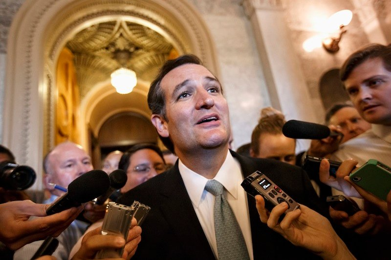 Sen. Ted Cruz, R-Texas talks to reporters as he emerges from the Senate Chamber on Capitol Hill in Washington, Wednesday, Sept 25, 2013, after his overnight crusade railing against the Affordable Care Act, popularly known as