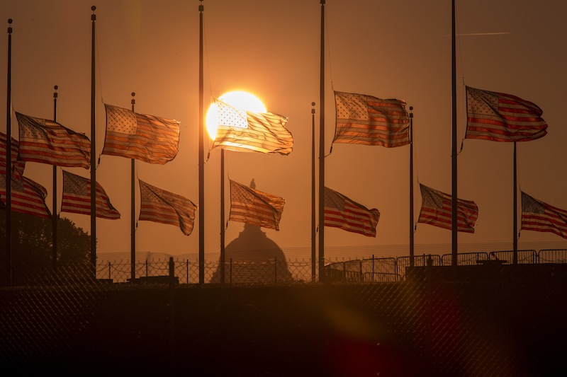 The American flags surrounding the Washington Monument fly at half-staff as ordered by President Barack Obama following the deadly shooting Monday at the Washington Navy Yard, Tuesday morning, Sept. 17, 2013, in Washington. (AP Photo/J. Scott Applewhite)