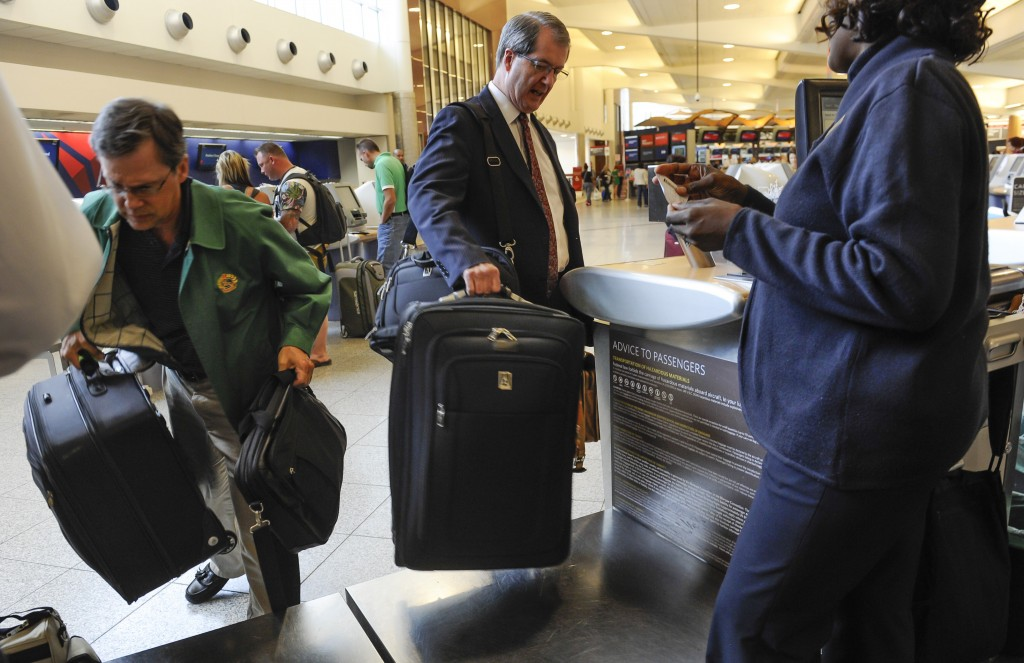 Passengers check in their luggage at the Delta counter at Hartsfield-Jackson Atlanta International Airport last week. Delta customers now have the option to purchase an upgrade that includes a free checked bag, among other perks.