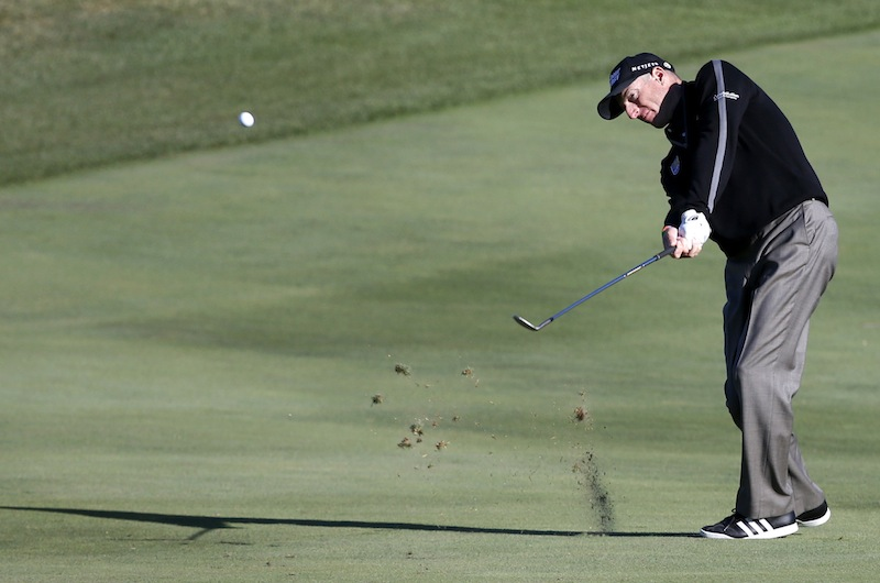 Jim Furyk hits his approach shot on the ninth fairway during the second round of the BMW Championship golf tournament at Conway Farms Golf Club in Lake Forest, Ill., on Friday. Furyk posted a single-round 59, becoming the sixth player to reach that milestone.