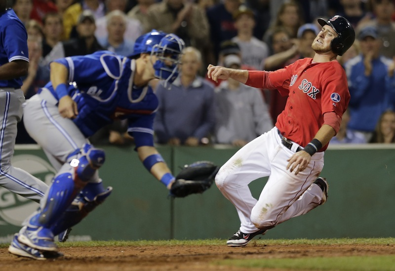 Will Middlebrooks, right, heads home to score on a single by Dustin Pedroia in the eighth inning.