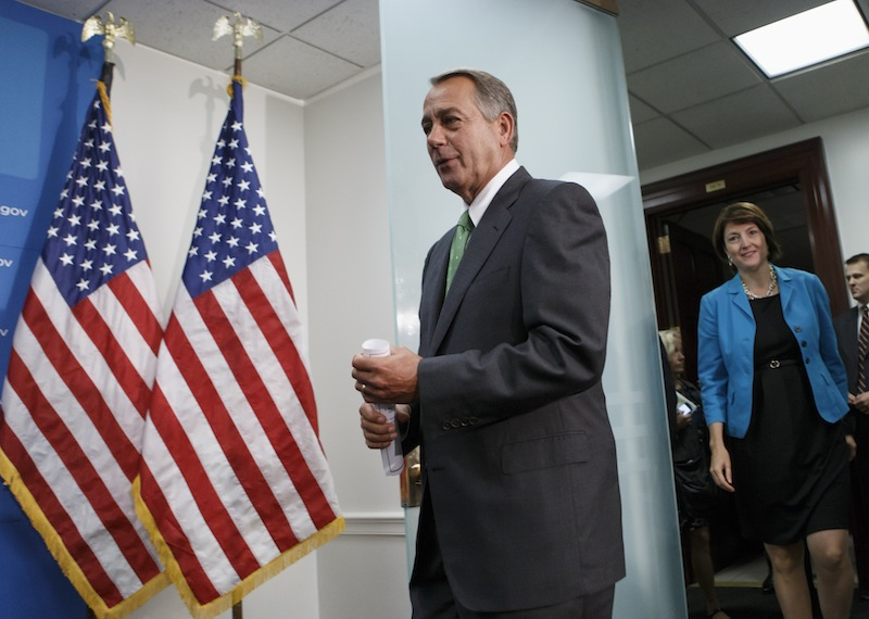 House Speaker John Boehner Ohio, followed by Rep. Cathy McMorris Rodgers, R-Wash., the Republican Conference chair, arrives to meet with reporters on Capitol Hill in Washington, Thursday, Sept. 26, 2013, after a closed-door strategy session. Pressure is building on fractious Republicans over legislation to prevent a partial government shutdown, as the Democratic-led Senate is expected to strip a tea party-backed plan to defund the Affordable Care Act, popularly known as