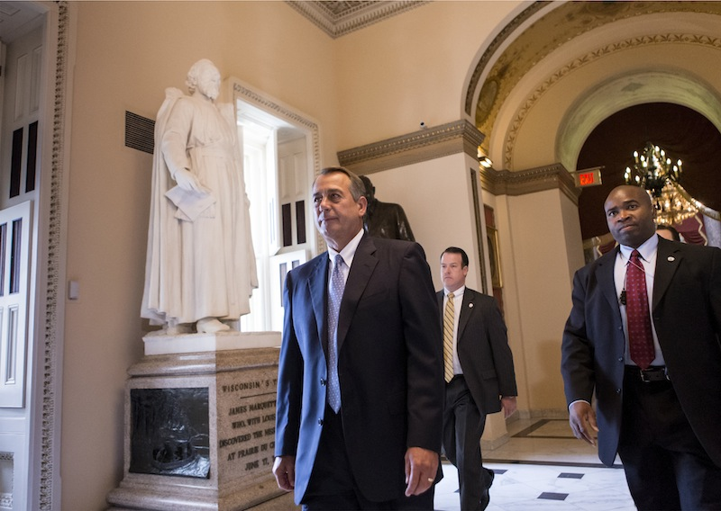 Speaker of the House John Boehner, R-Ohio, walks to the floor of the House as Congress continues to struggle over how to fund the government and prevent a possible shutdown, at the Capitol in Washington, Friday, Sept. 27, 2013.