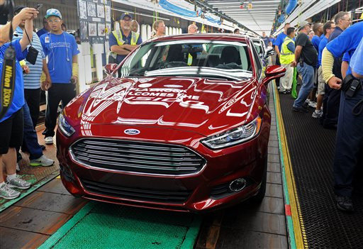 A new 2014 Ford Fusion is displayed on the line in Flatrock, Mich. last week. For the first time, Ford is making its Fusion sedan in the U.S.