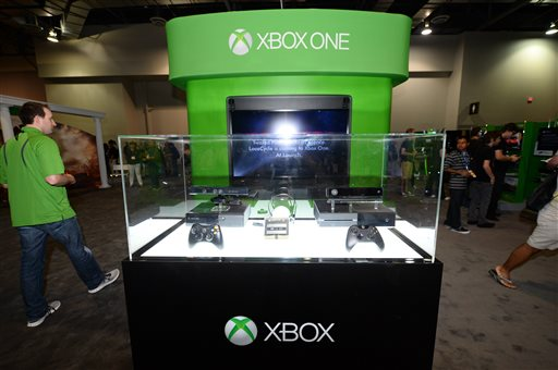 FILE - This Aug. 28, 2013 file photo shows a Microsoft Xbox One console at GameStop Expo, in Las Vegas. During a presentation at the GameStop Expo to promote the upcoming Xbox One console last week, a no-frills approach is exactly what Microsoft employed when confronted with a convention room full of passionate gamers. There were no flashy videos, sensational demonstrations or celebrity appearances. (Photo by Al Powers/Invision/AP, File)