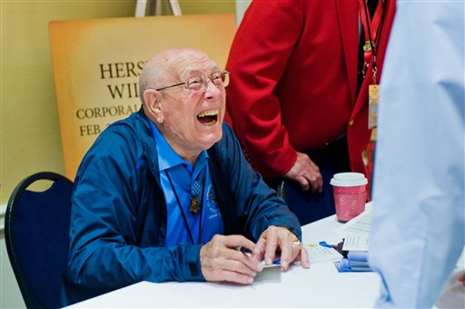 Hershel W. Williams shares a laugh with a conference attendee during the autograph session in Gettysburg. Williams was a corporal in the Marine Corps at Iwo Jima during World War II.