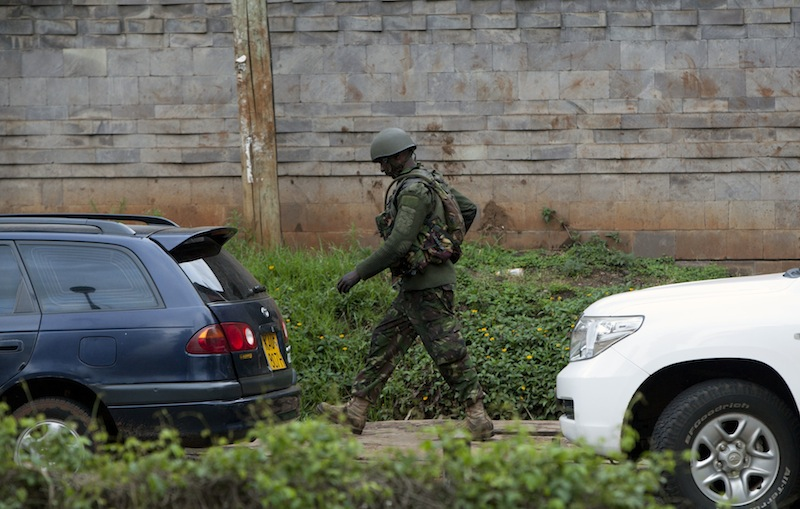 A Kenyan security forces soldier walks towards the Westgate Mall in Nairobi, Kenya Tuesday Sept. 24 2013. Gunfire has erupted sporadically on the fourth day of a hostage siege. Security forces have been attempting to rescue an unknown number of hostages inside the mall held by al-Qaida-linked terrorists.
