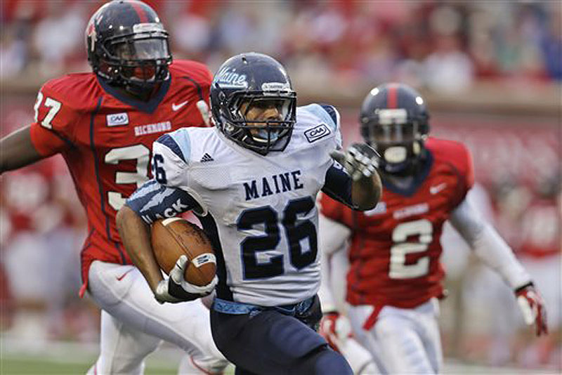 Maine running back Nigel Jones (26) runs for a touchdown in front of Richmond defensive backs Reggie Barnette (37) and Wayne Pettus (2) in the second half Saturday in Richmond, Va., Maine won 28-21.