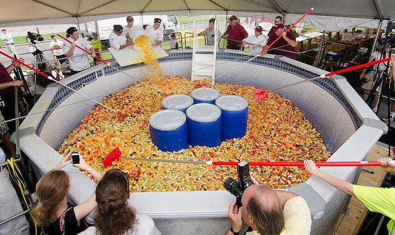 This Monday, Sept. 2, 2013 photo released on the University of Massachusetts, Amherst media relations website shows a fruit salad prepared on campus, and weighing more than 15,000 pounds. A Guinness World Records representative certified the big salad as a record. The school has held a food event that has become an annual tradition. Recent years have featured record-breaking seafood stews and stir fries. (AP Photo/University of Massachusetts, Amherst)