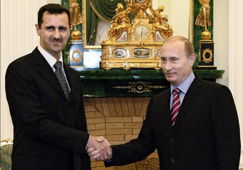 In this Tuesday, Dec. 19, 2006 file photo, Vladimir Putin, Russian President, right, and his Syrian counterpart Bashar Assad smile as they shake hands in Moscow's Kremlin. More Americans have negative views of Russian President Vladimir Putin than at any time since he came to power in 2000, a Gallup poll released Wednesday indicated. (AP photo/RIA Novosti, Mikhail Klimentyev, Presidential Press service)