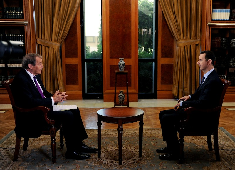 """In this Sunday, Sept. 8, 2013 photo released by the Syrian official news agency SANA, PBS host Charlie Rose, left, interviews Syrian President Bashar Assad at the presidential palace in Damascus, Syria. In an interview broadcast Monday, Sept. 9, 2013 on """"CBS This Morning,"""" Assad denied responsibility and accused the Obama administration of spreading lies without providing a """"single shred of evidence,"""" he warned that air strikes against his nation could bring retaliation. (AP Photo/SANA)"""