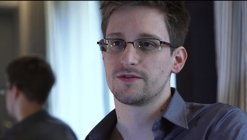 This photo provided by The Guardian Newspaper in London shows Edward Snowden, who worked as a contract employee at the National Security Agency, on Sunday, June 9, 2013, in Hong Kong. The National Security Agency, working with the British government, has secretly been unraveling encryption technology that billions of Internet users rely upon to keep their electronic messages and confidential data safe from prying eyes, according to published reports Thursday, Sept. 5, 2013, based on internal U.S. government documents. (AP Photo/The Guardian, Glenn Greenwald and Laura Poitras)