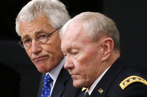 Defense Secretary Chuck Hagel, left, and Chairman of the Joint Chiefs of Staff Gen. Martin Dempsey speak during a press conference on military base security on Wednesday at the Pentagon.