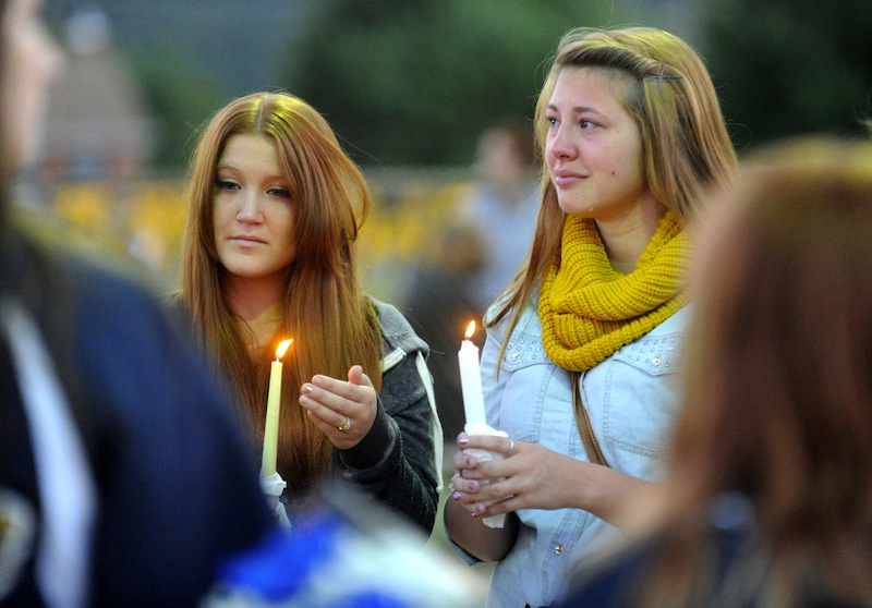 Megan Ridgell, left, and Colette Turner take part in a candlelight vigil in honor of Richard Michael Ridgell, Megan's father, at Jaycee Park in Westminster, Md. Tuesday, Sept. 17, 2013. Ridgell was killed in Monday's shooting at the Navy Yard in Washington. (AP Photo/Carroll County Times, Dave Munch) #forsale