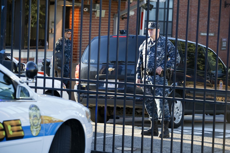 Members of the Navy guard inside of the closed Washington Navy Yard in Washington, on Tuesday, Sept. 17, 2013, the day after a gunman launched an attack inside the Washington Navy Yard on Monday, spraying gunfire on office workers in the cafeteria and in the hallways at the heavily secured military installation in the heart of the nation's capital. Only essential personnel were being permitted inside, according the authorities. (AP Photo/Jacquelyn Martin)