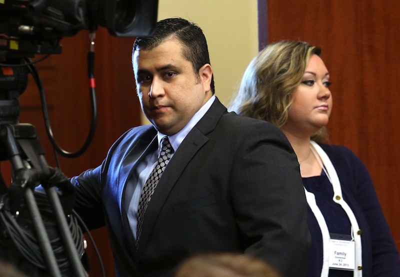 In this Monday, June 24, 2013 file photo, George Zimmerman, left, arrives in Seminole circuit court with his wife, Shellie, on the 11th day of his trial, in Sanford, Fla. George Zimmerman's wife filed for divorce Thursday, Sept. 5, 2013 less than two months after her husband was acquitted of murdering Trayvon Martin and a week after she pleaded guilty to perjury in his case. (AP Photo/Orlando Sentinel, Joe Burbank, Pool, File)