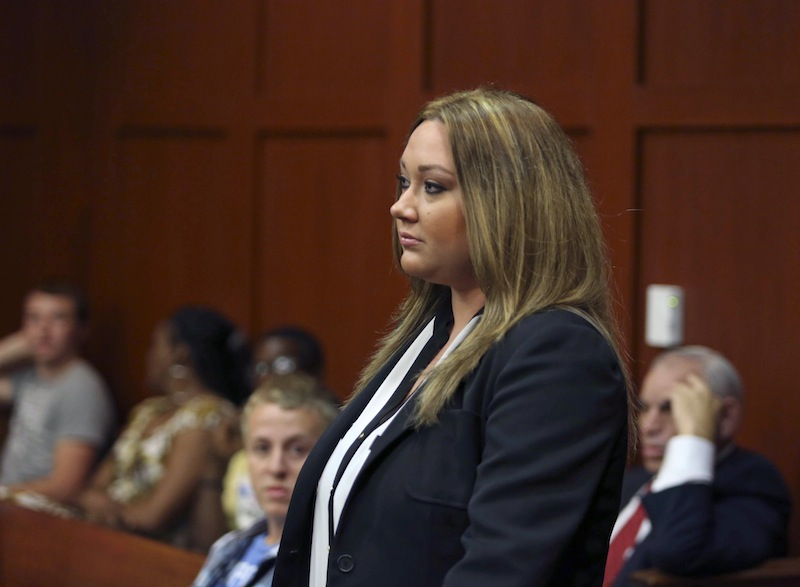 Shellie Zimmerman, wife of George Zimmerman, appears at the Seminole County Courthouse in Sanford, Fla. on Aug. 28. She filed for divorce on Thursday, her defense lawyer confirmed.