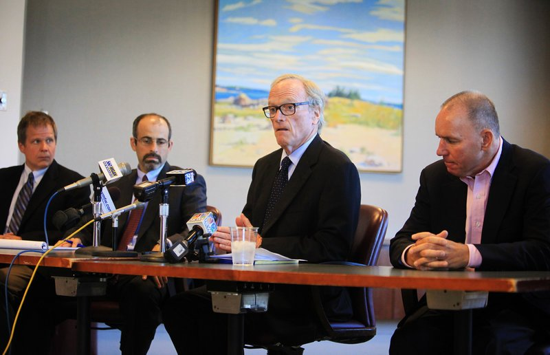 Harold Friedman, second from right, of Verrill Dana LLP in Portland gives a news conference regarding a Portland Pirates lawsuit Friday. Joining Friedman are, from far left, Brett Leland and John Giffume, also with Verrill Dana, and John Petrovek, far right, part-owner of the Portland Pirates.