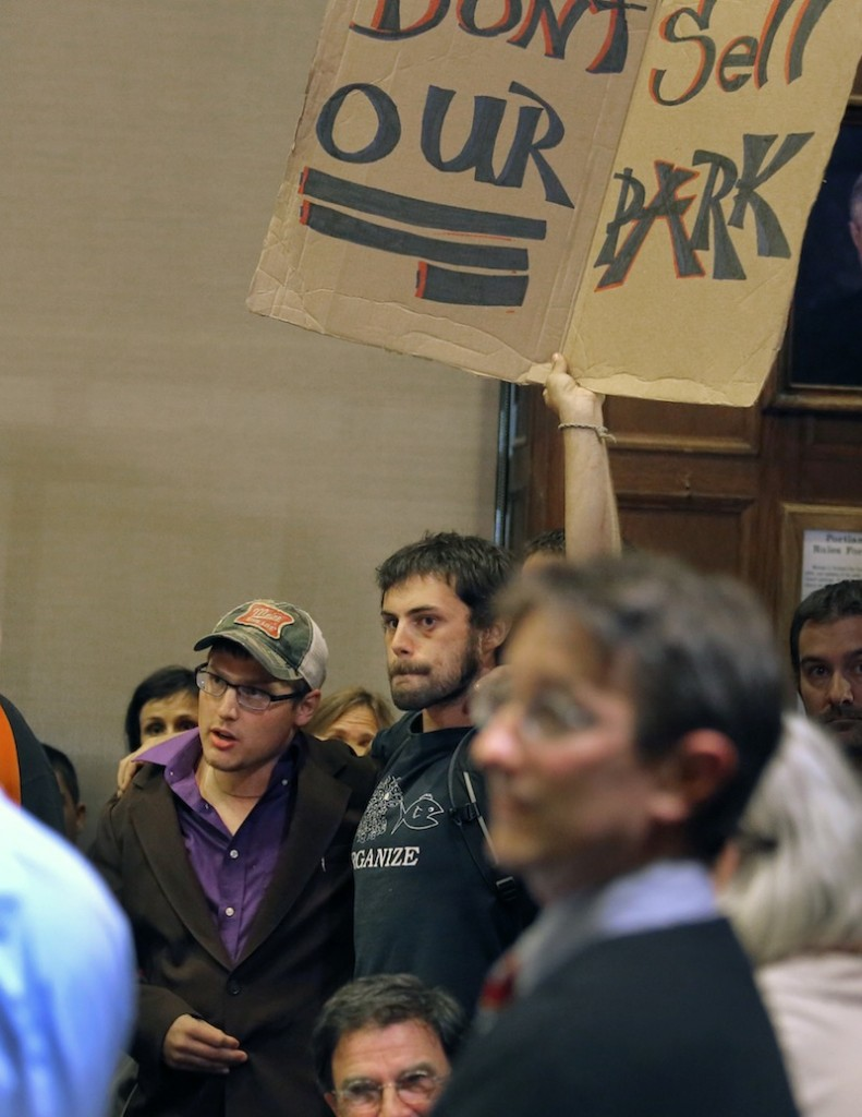 Two men who refused to give their names appeared briefly at the Portland City Council meeting Monday, September 9, 2013, to protest the sale of Congress Square.