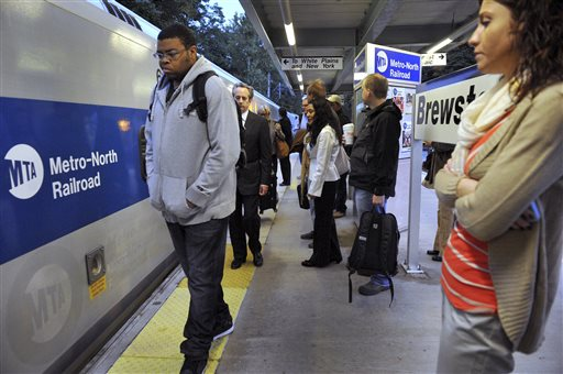 Commuters wait Thursday at the Brewster, N.Y., station for the 6:44 a.m. train to Grand Central Station in New York. A power failure on the rail line in the Stamford, Conn., area Wednesday disrupted travel for tens of thousands of commuters heading into the city.