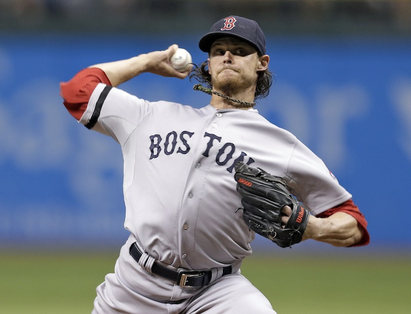 Boston Red Sox starting pitcher Clay Buchholz delivers to Tampa Bay Rays' David DeJesus on Tuesday in St. Petersburg, Fla.