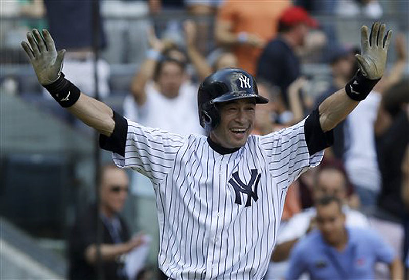New York's Ichiro Suzuki reacts with glee after scoring the winning run on a wild pitch in the ninth inning at Yankee Stadium on Sunday afternoon.