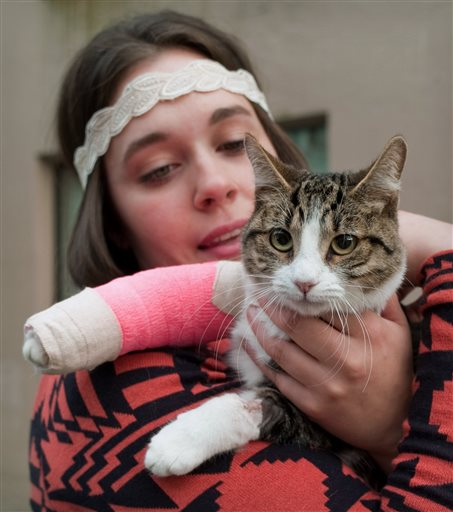 Stephanie Gustafson holds her 2-year-old female cat, Wasabi, after returning from a veterinarian hospital in Juneau, Alaska.