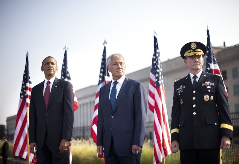 President Barack Obama, left, Secretary of Defense Chuck Hagel, center, and Joint Chiefs of Staff Chairman Gen. Martin Dempsey, right, on stage at the Pentagon in Washington, Wednesday, Sept. 11, 2013, to mark the 12th anniversary of the 9/11 attacks. (AP Photo/Pablo Martinez Monsivais)