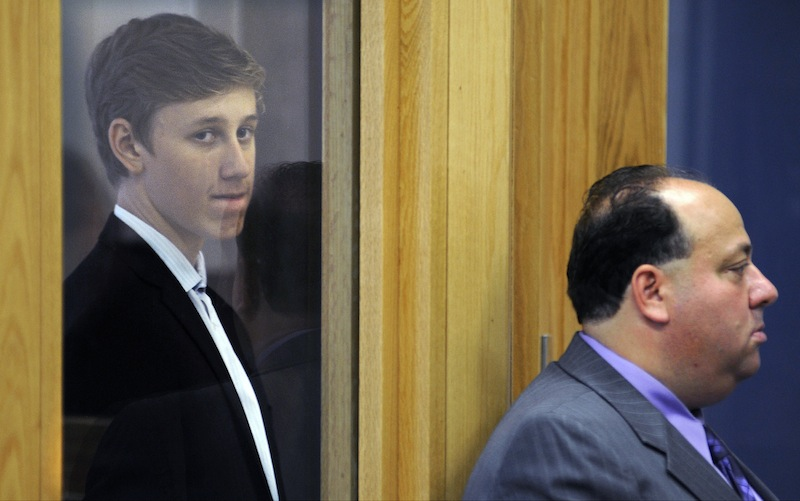Galileo Mondol, 17, left, of Somerville, Mass., stands with his attorney William A. Korman, right, during his arraignment at Central Berkshire District Court Tuesday, Sept. 3, 2013, in Pittsfield, Mass. Mondol is charged with sexually assaulting three younger students at Camp Lenox on Aug. 25 in Otis, Mass., during a Somerville High School team-building retreat for the soccer team. (AP Photo/The Boston Globe, Christine Peterson, Pool)