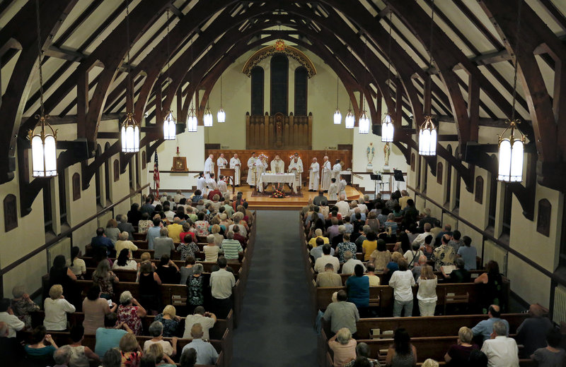 Parishioners at St. John the Evangelist Catholic Church in South Portland celebrated their last Mass Wednesday night. The church will merge with Holy Cross, also in South Portland, and the building will be sold.