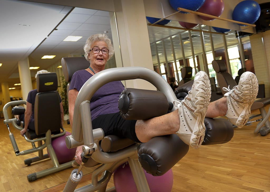 80-year-old Marianne Blomberg works out at a gym in Stockholm. The Swedish government has suggested people continue working beyond 65, a prospect Blomberg cautiously welcomes but warns should not be a requirement.