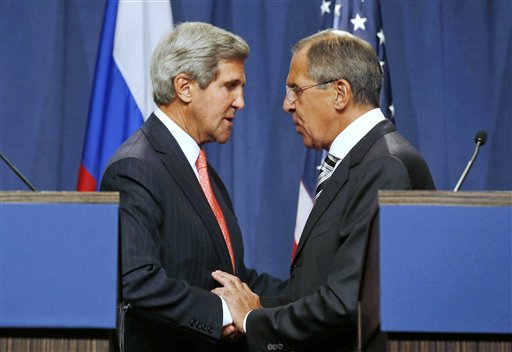 U.S. Secretary of State John Kerry, left, and Russian Foreign Minister Sergei Lavrov shake hands Saturday after making statements at a news conference following meetings regarding Syria in Geneva, Switzerland. :rel:d:bm:GF2E99E0UWF01