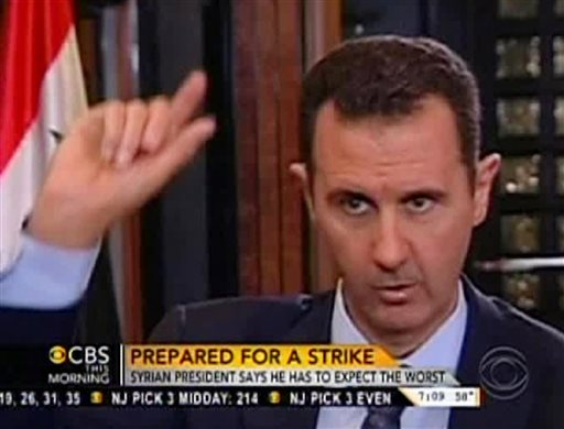 """In this frame grab from video provided by """"CBS This Morning,"""" Syrian President Bashar Assad responds to a question from journalist Charlie Rose during an interview in Damascus, Syria."""