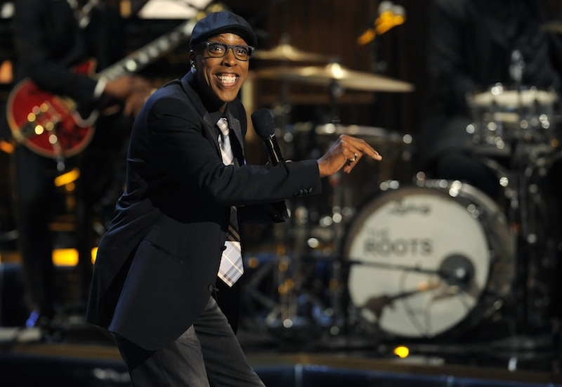 """This Nov. 3, 2012 file photo shows Arsenio Hall performing at """"Eddie Murphy: One Night Only,"""" a celebration of Murphy's career in Beverly Hills, Calif. After two decades, Hall is returning to late night television with """"The Arsenio Hall Show,"""" premiering on Sept. 9. (Photo by Chris Pizzello/Invision/AP, File) Black Blazer,Black Hat,Black Jacket,Eyewear,Glasses,Live Performance,Long Sleeve,Long Sleeves,On Stage,One Person,Perform,Performance,Performing,Smile,Smiling,Speak,Speaking,Spectacles,Talk,Talking"""