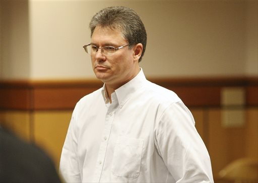 Stacey Rambold stands in a courtroom after sentencing by Judge G. Todd Baugh in Billings, Mont., in this Aug. 26, 2013, photo. Another Montana judge has ordered a new sentencing hearing for the former teacher who received just 30 days in prison for raping a student who later killed herself.