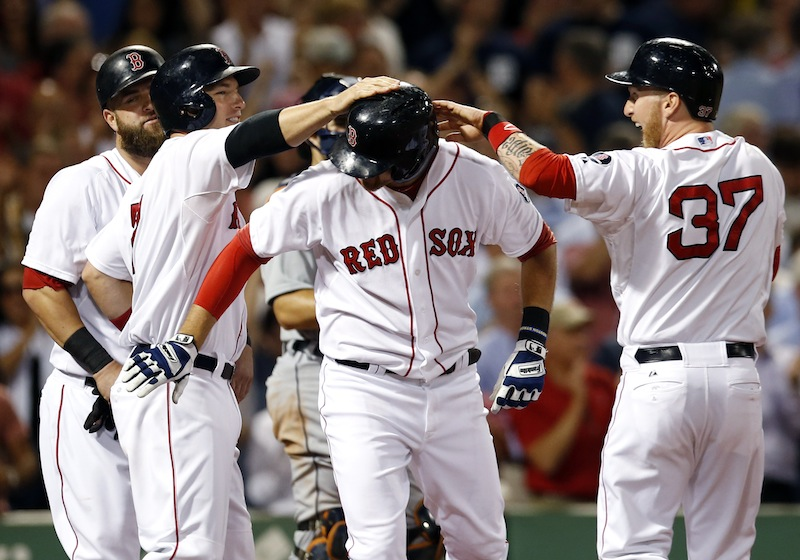 Boston Red Sox's Will Middlebrooks celebrates with teammates, from left, Mike Napoli, Stephen Drew, and Mike Carp (37) after hitting a grand slam against the Detroit Tigers in the sixth inning of a baseball game at Fenway Park in Boston, Wednesday, Sept. 4, 2013. (AP Photo/Elise Amendola)