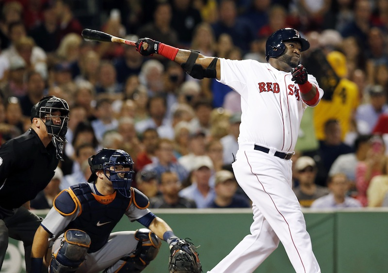 Boston Red Sox designated hitter David Ortiz follows through on a solo home run as Detroit Tigers catcher Alex Avila watches during the fourth inning of a baseball game at Fenway Park in Boston, Wednesday, Sept. 4, 2013. (AP Photo/Elise Amendola)