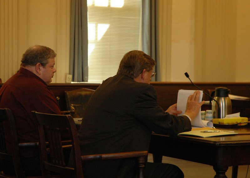 Timothy Courtois, left, sits next to his attorney, Clifford Strike, at a hearing Thursday in York County Superior Court in Alfred. Timothy Courtois