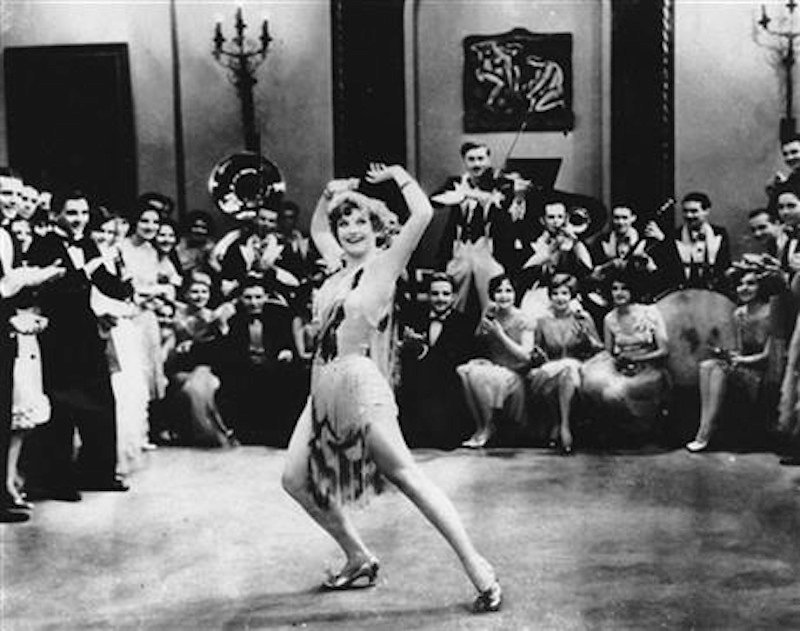 """In this 1928 file photo, Actress Joan Crawford is seen dancing the Charleston in """"Our Dancing Daughters"""" in Hollywood, Calif. A report released, September, 10, 2013, shows that the very wealthiest Americans earned more than 19 percent of the country's household income in 2012, their biggest share since 1928. And the top 10 percent captured a record 48.2 percent of total earnings last year. (AP Photo/File)"""