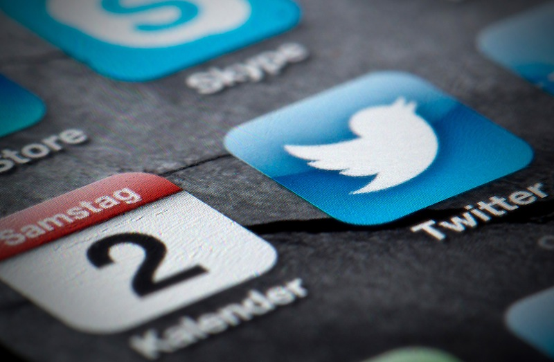 This Feb. 2, 2013, file photo shows a Twitter icon on the display of a smartphone in Berlin. The Associated Press