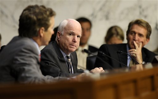 Senate Foreign Relations Committee members Sen. John McCain, R-Ariz, center, and Sen. Rand Paul, R-Ky., left, talk on Capitol Hill Wednesday during the committee's hearing to consider the authorization for use of military force in Syria. Sen. Jeff Flake, R-Ariz. is at right.