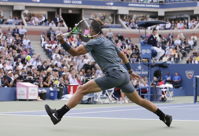 Rafael Nadal, of Spain, returns a shot to Novak Djokovic, of Serbia, during the men's singles final of the 2013 U.S. Open tennis tournament, Monday, Sept. 9, 2013, in New York. (AP Photo/Charles Krupa)