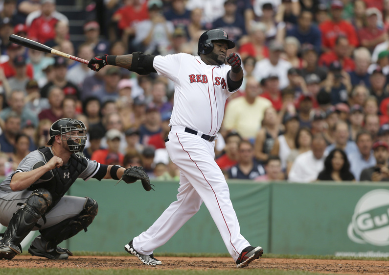 Boston's David Ortiz hits an RBI double off a pitch by Chicago's Andre Rienzo as White Sox catcher Tyler Flowers watches in the second inning at Fenway Park in Boston on Sunday. The Red Sox won, 7-6.