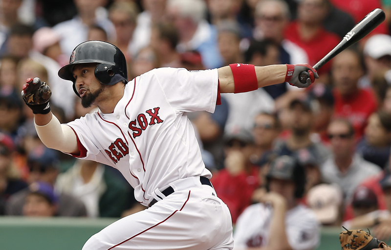 Boston's Shane Victorino follows through with an RBI single against the New York Yankees during the fourth inning at Fenway Park on Saturday.