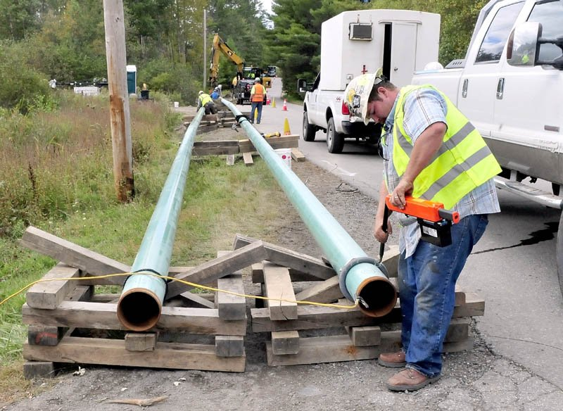 Jeremy Clubbs, of the sub-contractor U.S. Pipelines company, works on preparing to install gas pipeline sections outside Sappi in Skowhegan on Wednesday, Sept. 25, 2013. The spur will connect the mill to a main line running through Fairfield.