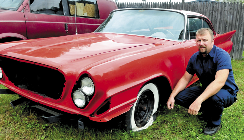 Dominick Rinaldi ll beside a rare 1961 Chrysler 300 G vehicle undergoing restoration that was vandalized last weekend at his Rinaldi and Sons shop in Skowhegan. Rinaldi said the vehicle sustained four slashed tires, a broken windshield and the roof and hood were dented after being walked on. Several other cars and a boat were also damaged.