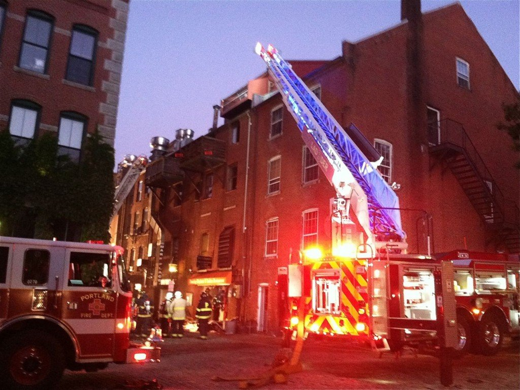 Firefighters respond to the scene of a fire in the 400 block of Fore Street early Thursday morning.